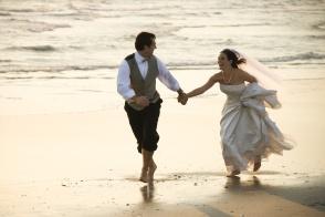 running down beach.
